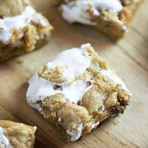 Fluffernutter Cookie Bars! These soft and chewy peanut butter cookie bars are so easy to make and loaded with marshmallow fluff and Reese's!