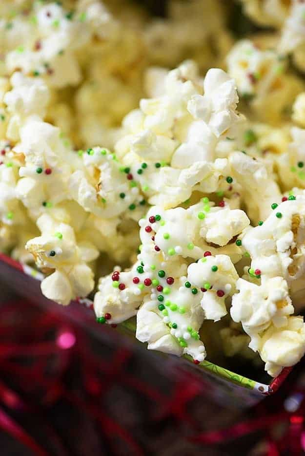 This white chocolate Christmas popcorn is one of my favorite holiday treats! It's so easy and everyone loves to munch on it!