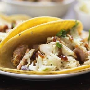 These crunchy pork tacos use pork that's been fried in the oven. They're topped with a simple slaw and barbecue.