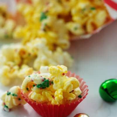 mini cups full of popcorn covered in sprinkles.