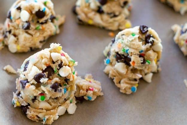 balls of cookie dough on baking sheet.