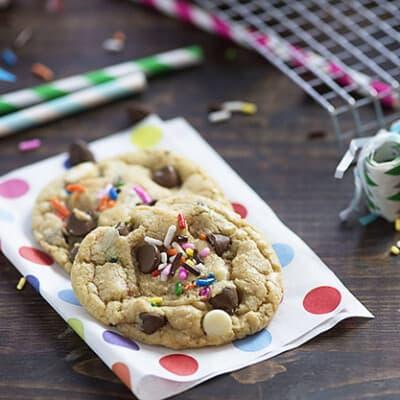 Chocolate chip cookies on a folded polka dot napkin.