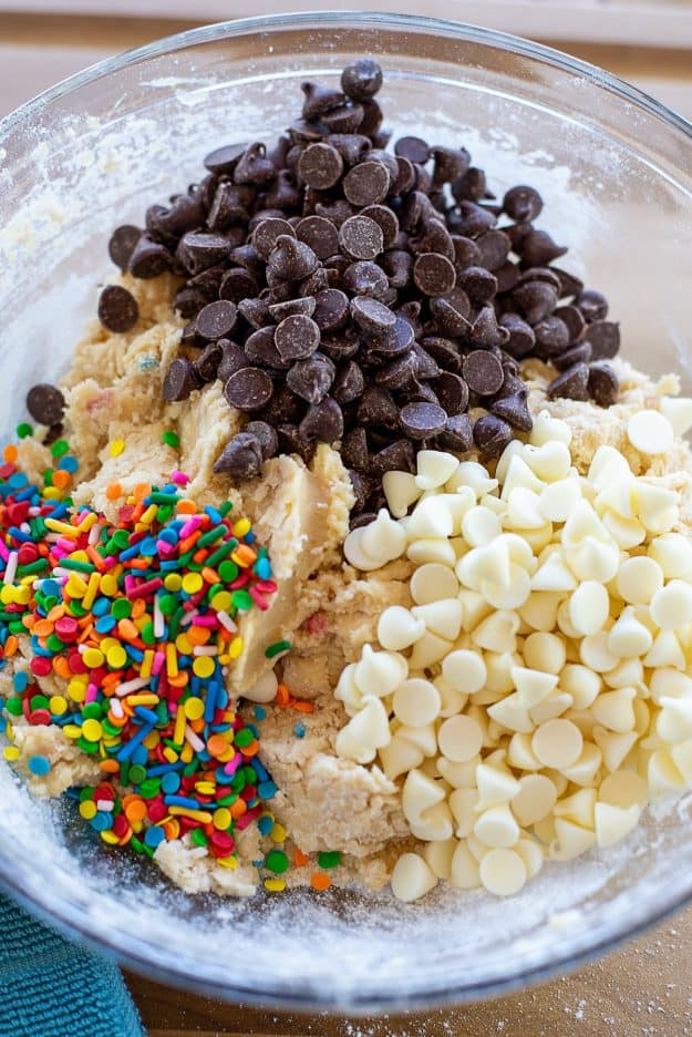 sprinkles and chocolate chips in bowl of cookie dough.
