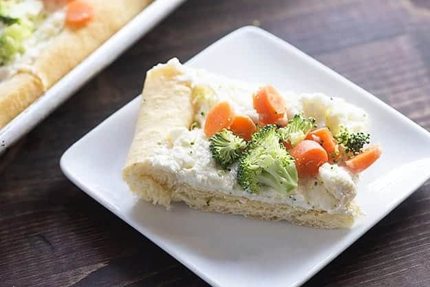 This vegetable pizza recipe has a thick layer of cream cheese flavored with ranch! It's the perfect appetizer or snack!