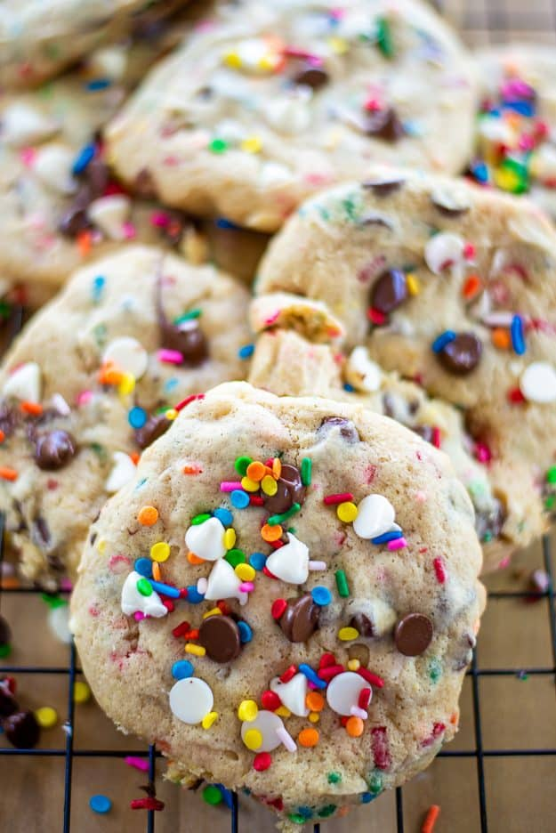 cake batter cookies with sprinkles on wire cooling rack.