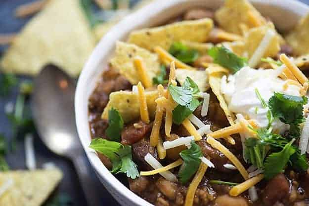 A close up of a bowl of taco chili.