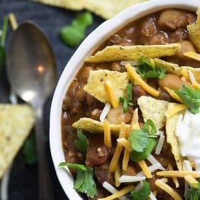 This taco chili is absolutely loaded with beans and taco meat! I topped it off with tortilla chips, cheese, and sour cream.