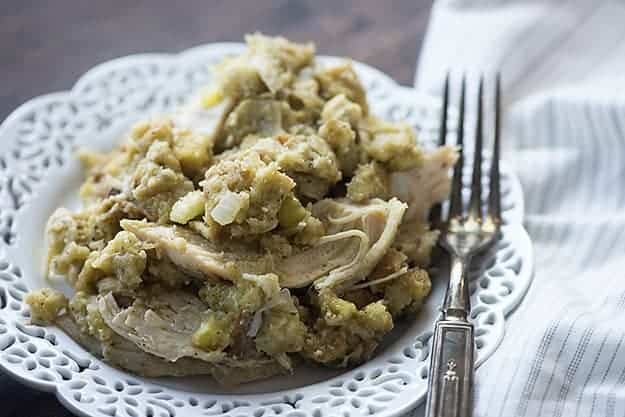 This crock pot chicken and stuffing is total comfort food! The chicken is tender and the stuffing mix cooks right in the slow cooker with the chicken!
