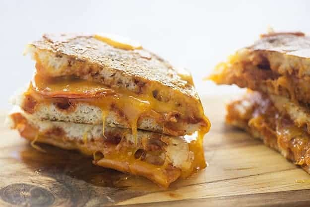 My favorite way to make a pizza is in an English muffin grilled cheese! All the flavor in a fraction of the time!