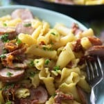 This cheesy pasta recipe is loaded with sun-dried tomatoes and smoked sausage. It's ready in about 25 minutes in just one dish!