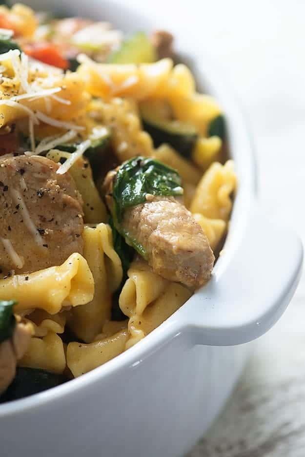 Pork and macaroni noodles in a white bowl.