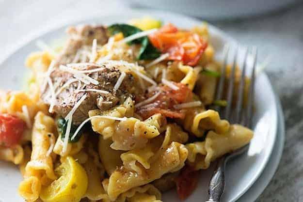 A close up of a plate of pork pasta