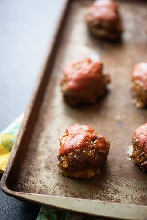 A few meatloaf meatballs on a baking sheet.