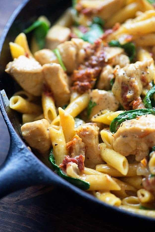 This chicken florentine pasta is made in one skillet and ready in 25 minutes. It's full of chicken, sun-dried tomatoes, and spinach!