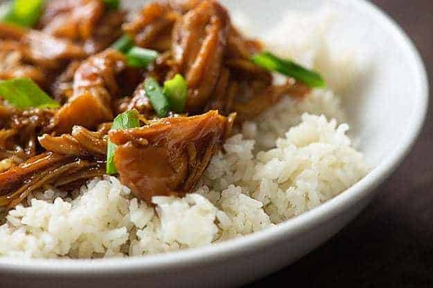 bourbon chicken on white rice in bowl