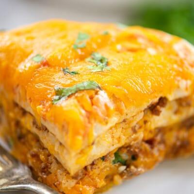 layered burrito casserole on plate.
