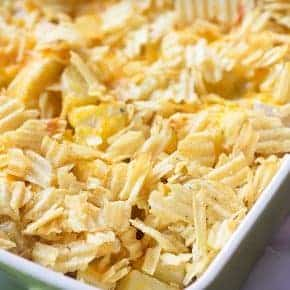 These cheesy ranch potatoes are the perfect side dish! Tender potatoes, cheddar and ranch, and it's all topped with crunchy potato chips!