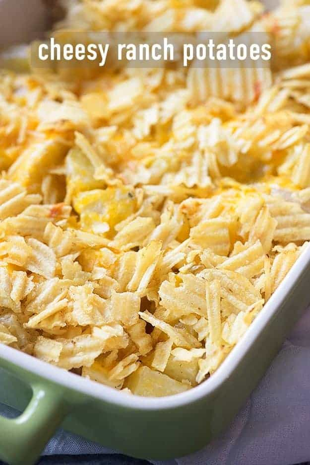 A close up of cheesy potatoes in a baking pan.