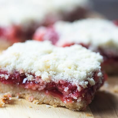 A close up of a piece of cherry pie bars.