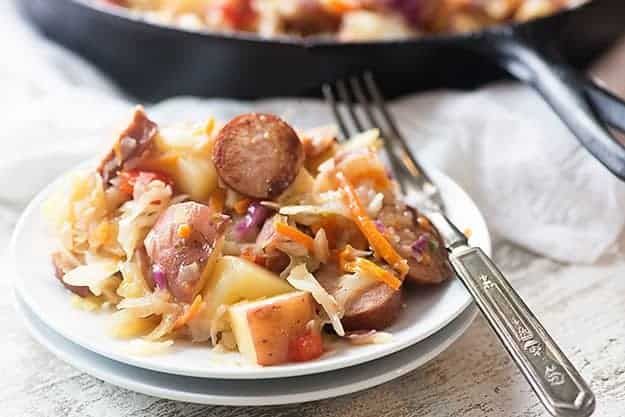 This fried cabbage recipe is packed with smoked sausage and potatoes and tossed in a tangy sauce!