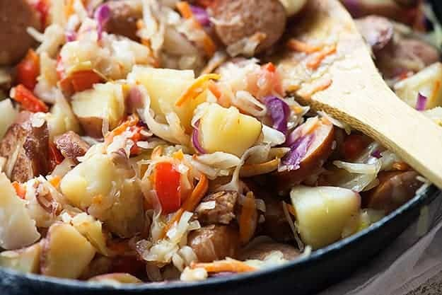 This cabbage and sausage recipe is packed with smoked sausage and potatoes and tossed in a tangy sauce!