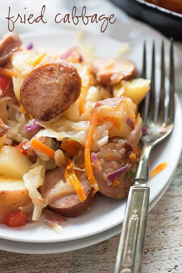This fried cabbage is packed with smoked sausage and potatoes and tossed in a tangy sauce!