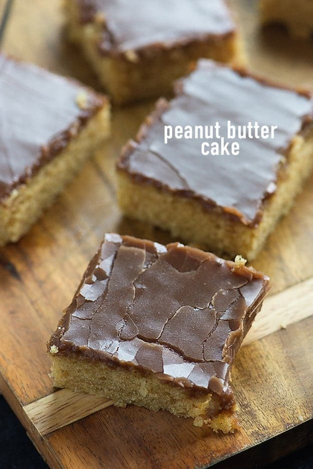 This peanut butter sheet cake is bursting with peanut butter flavor! It's a super moist cake topped with a chocolate peanut butter frosting!