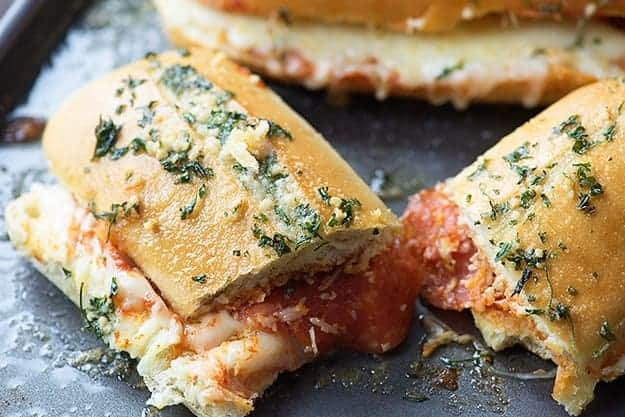 This pizza bread sandwich is a serious crowd pleaser! The garlic butter on top just makes it!
