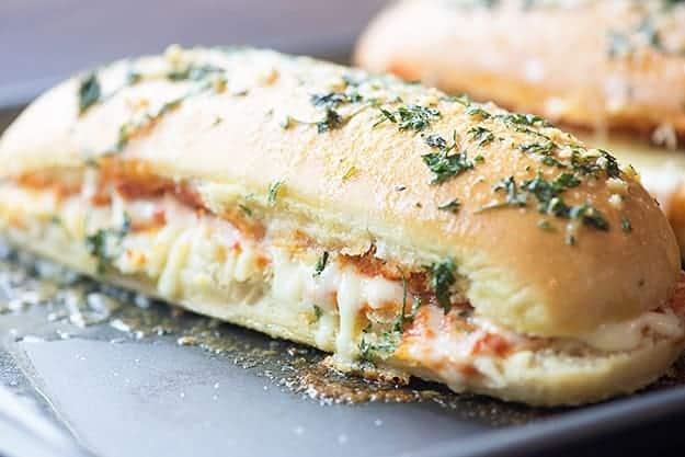 A pizza bread sandwich on a baking sheet.
