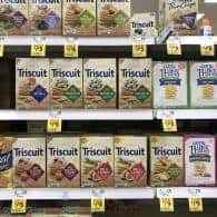 Several boxes of triscuit on a grocery store shelf.