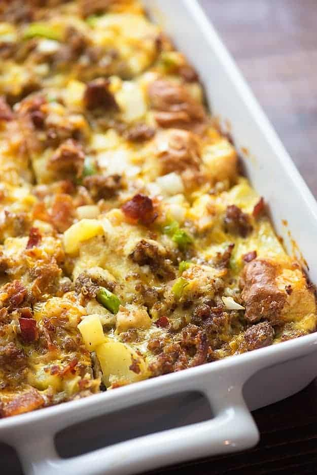 This recipe for breakfast casserole is packed with sausage, bacon, cheese, and eggs! It's so simple to throw together before bed and bake in the morning.