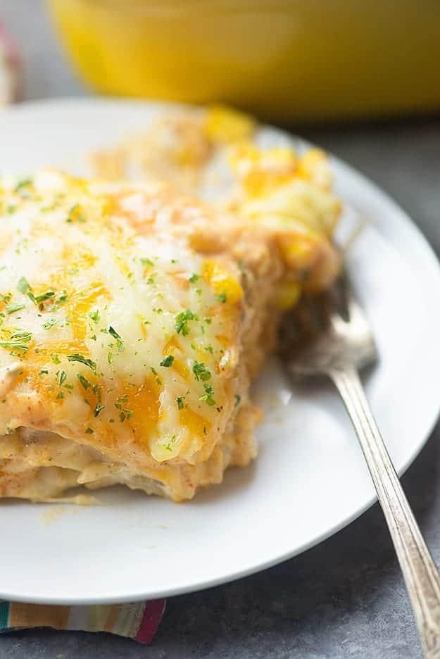 Enchilada casserole on a white plate.