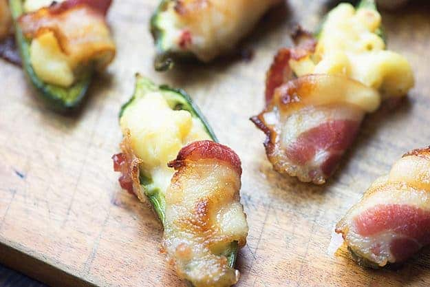 These bacon wrapped jalapeno poppers are stuffed with an extra creamy white cheddar mac and cheese!