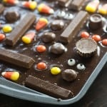 A bunch of candy placed into brownie batter.