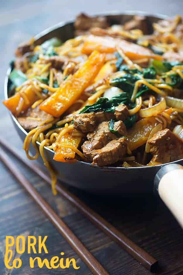 This easy lo mein recipe is full of pork, bell peppers, onions, and spinach. It's ready in less than 30 minutes and even tastier than take out!