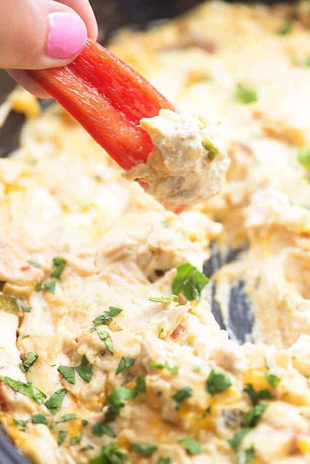 This spicy chicken dip is perfect football food! We love it with crackers and fresh peppers for dipping.