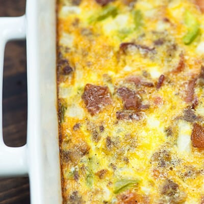 We love this make ahead breakfast casserole! It's naturally low carb and packed with bacon and sausage.