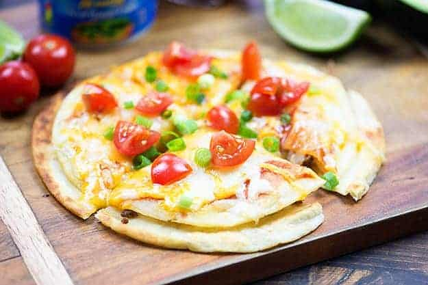 We love to serve this Mexican pizza recipe at the big game. Makes a great snack or appetizer.