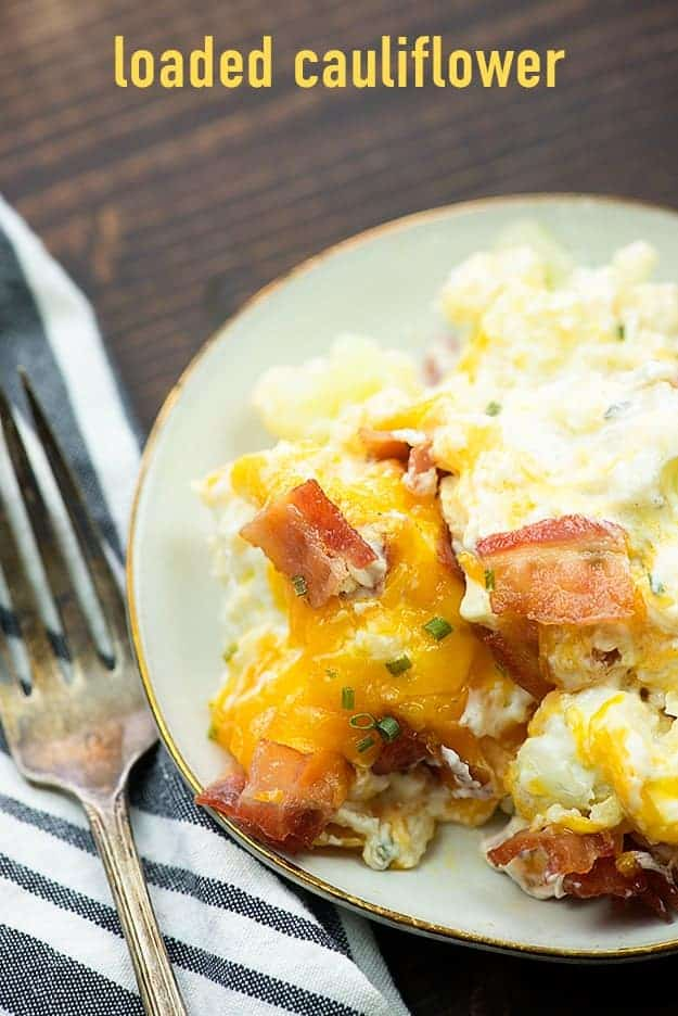 This loaded cauliflower bake is full of cream cheese, cheddar, bacon, and cauliflower. It's a great low carb side dish and perfect for the keto diet. #keto #lowcarb #healthy #sidedish