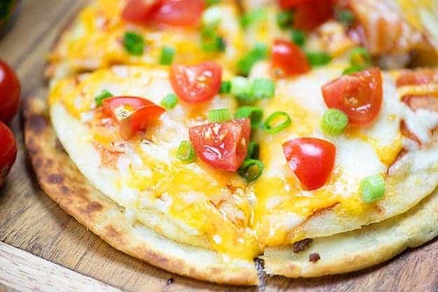 My Mexican pizza recipe is such a simple way to get dinner on the table or feed a hungry crowd! Makes a great snack or lunch.
