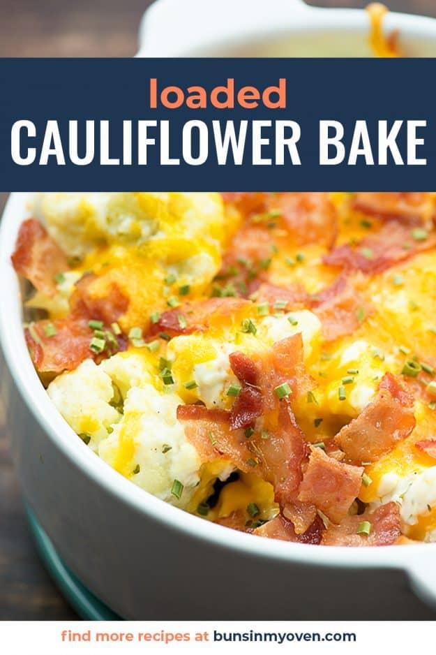 loaded cauliflower casserole in white baking dish.