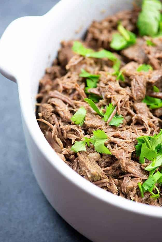 This Instant Pot beef barbacoa is perfect in tacos or burritos! So tender and full of flavor.