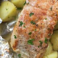 baked pork chops and potatoes in foil packet