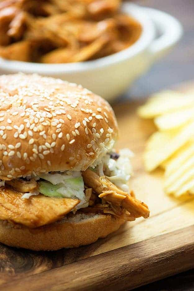 close up of crockpot bbq chicken on a bun