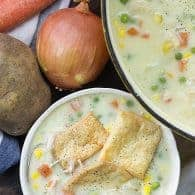 chicken pot pie soup in white bowl