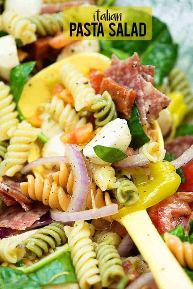 Try this Italian Pasta Salad with pepperoni, salami, mozzarella, and more! It's such a crowd pleaser! #bunsinmyoven #pastasalad #recipes