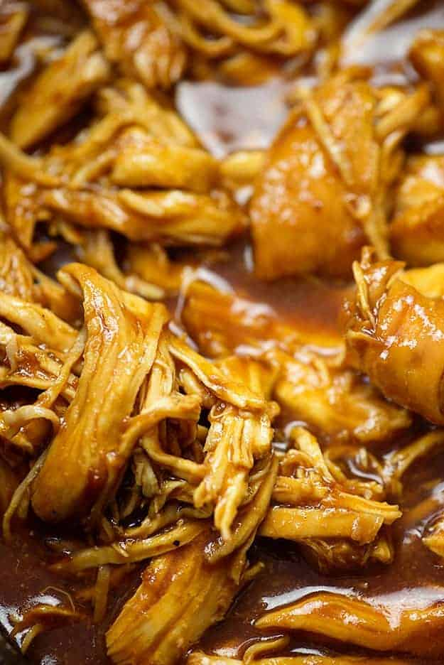 close up of BBQ pulled chicken in slow cooker