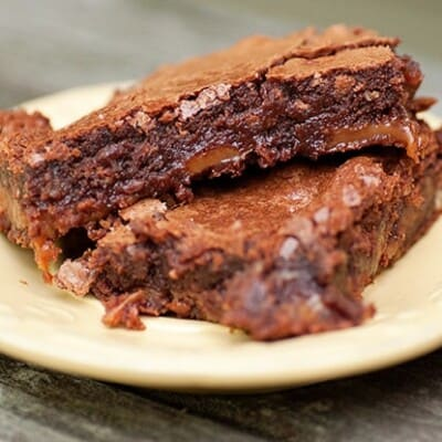 Two turtle brownies on a plate