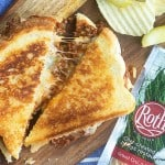 sloppy joe grilled cheese on wooden cutting board