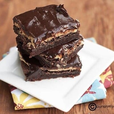 A stack of buckeye brownies on a folded cloth napkin